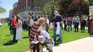 Barbers Cut Hair On The Michigan Capitol Lawn To Protest Anti-Coronavirus Shutdown